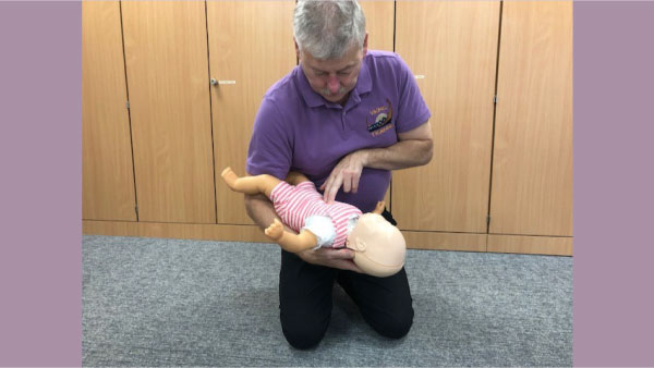 trainer-performing-chest-compressions-on-babyin-arms-600.jpg